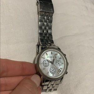 Michael Korda silver watch